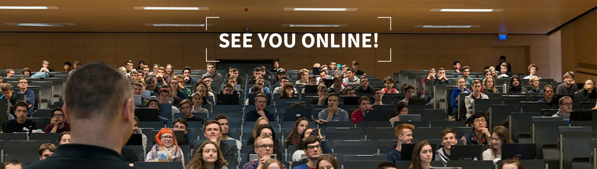 Picture of students in lecture hall with caption: See you online!